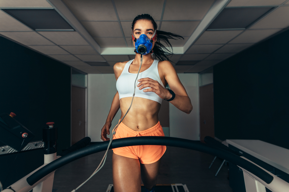 Female athlete in sports science lab measuring her VO2