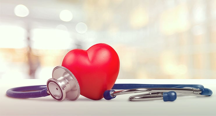 Plastic Heart Wrapped In A Stethoscope